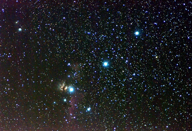 The three stars in Orion's belt, shining blue on a black background.