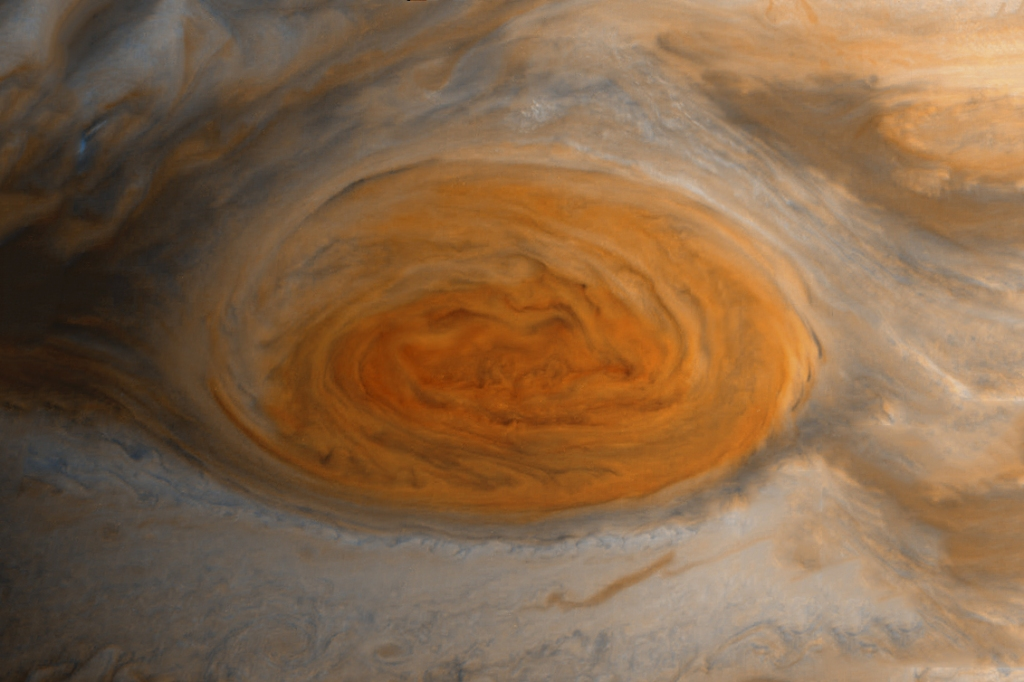The orange of the Great Red Spot against the pale beige of Jupiter