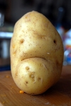 A picture of a potato with a sad face